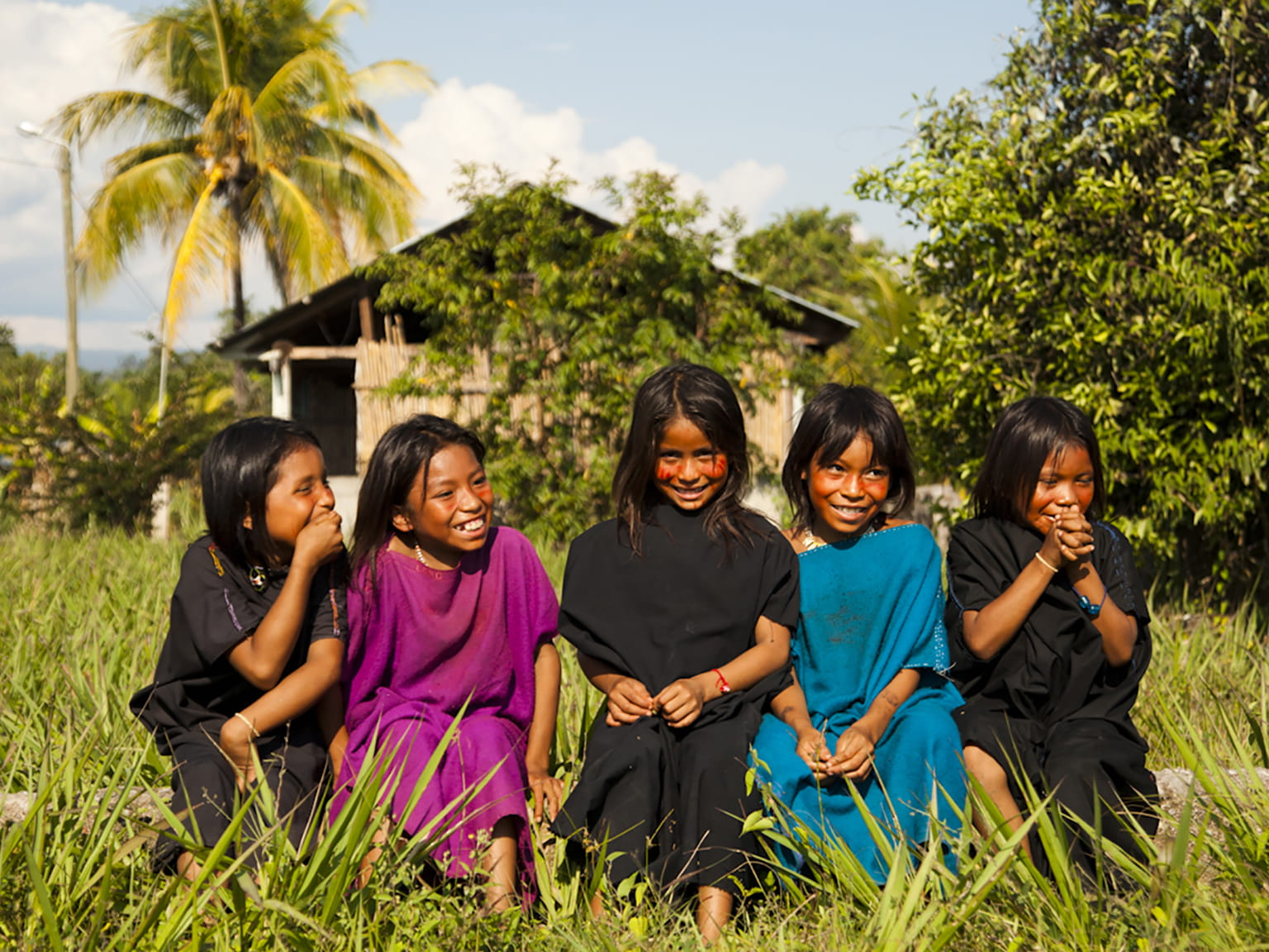 5 girls from cutivireni village laughing in a field