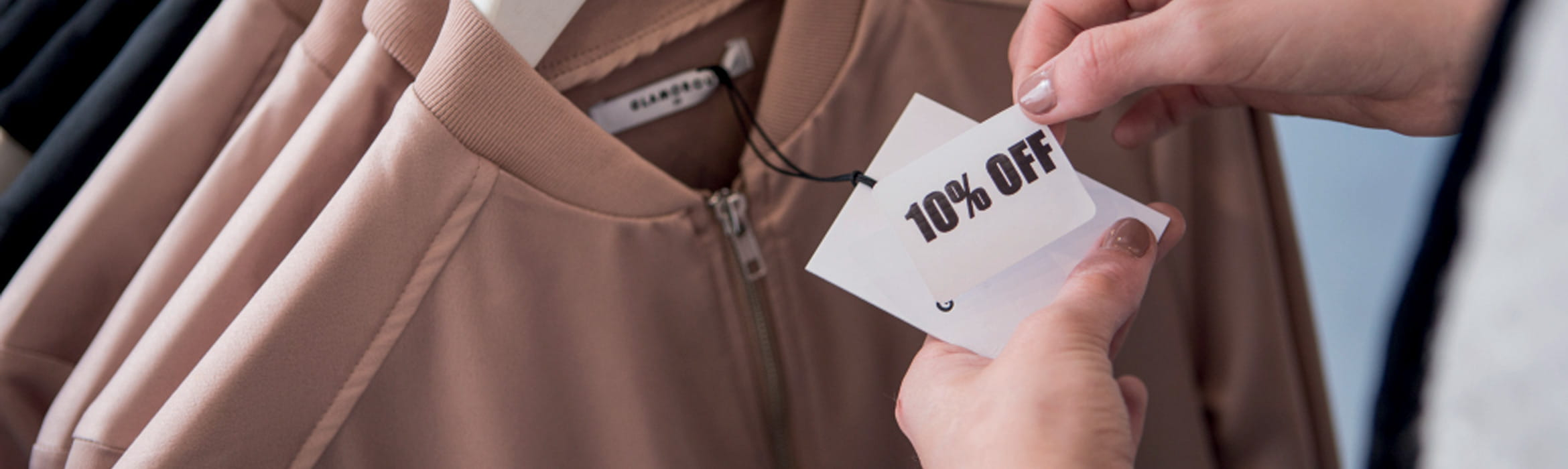 10% off mark-down label being applied to clothing