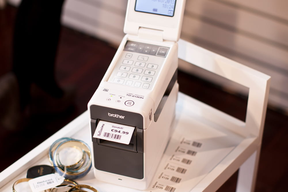 Brother TD-2000 series label printer on mobile trolley with barcode price label printed