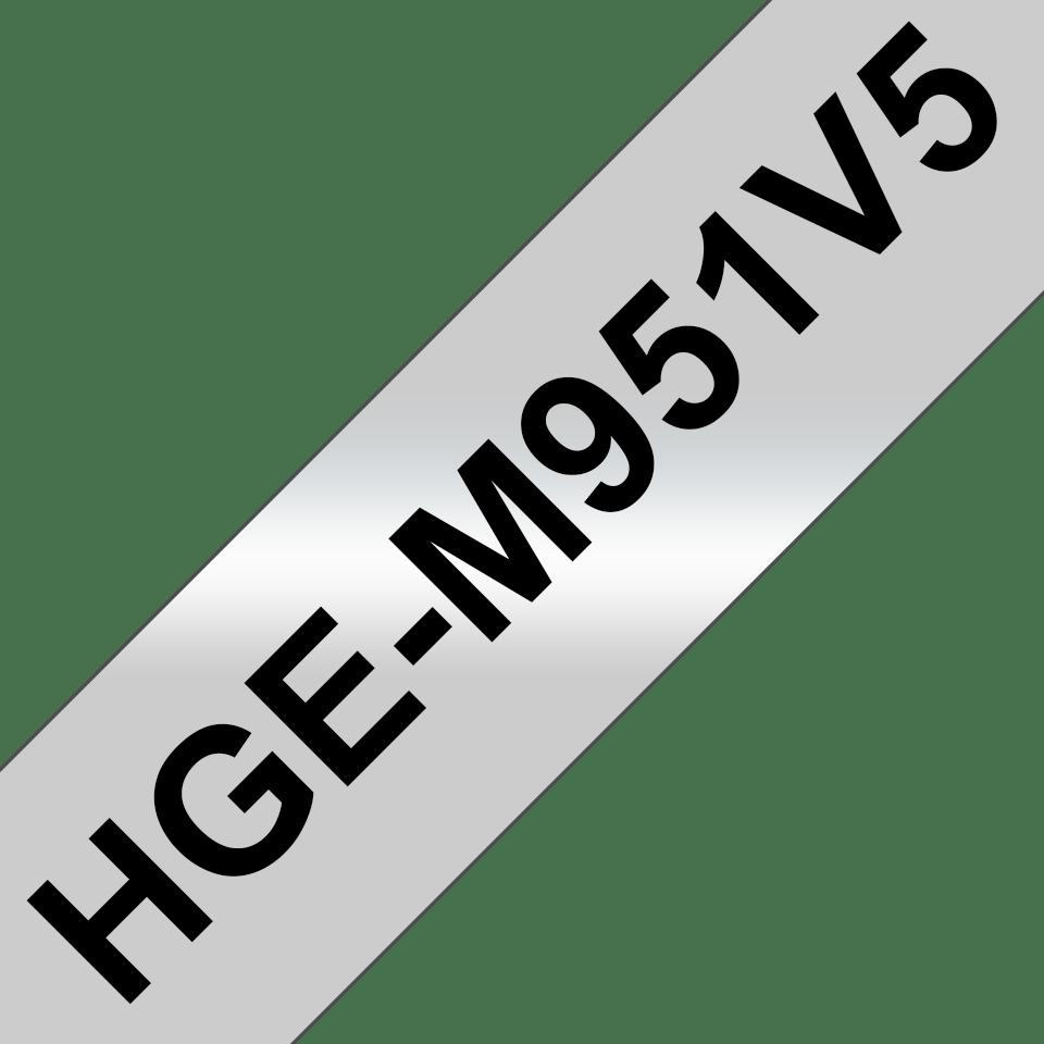 Originální štítek Brother HGe-M951V5 - černá na stříbrné, 24 mm šířka
