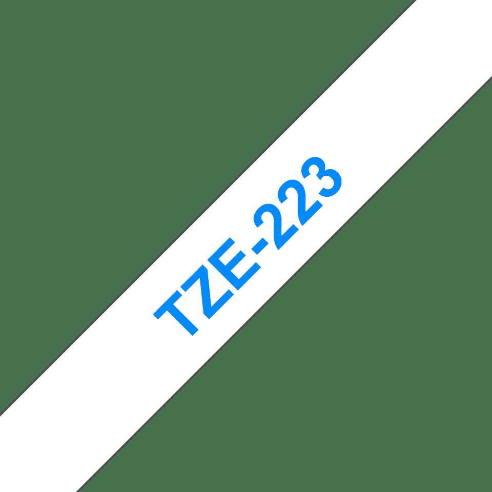 Originální kazeta s páskou Brother TZe-223 - modrý tisk na bílé, šířka 9 mm