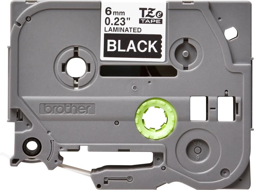 Originální kazeta s páskou Brother TZe-315 - bílý tisk na černé, šířka 6 mm